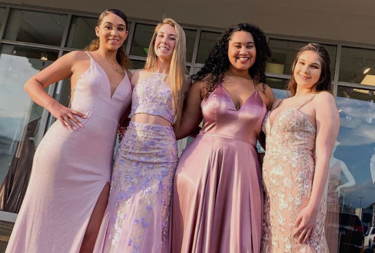 Girls wearing evening dresses
